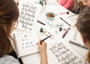 students learning calligraphy in seattle class
